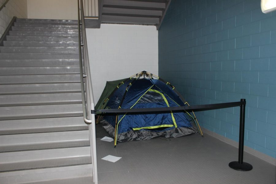 The+mysterious+tent+appeared+around+two+months+ago.+Rumors+have+been+circulating+among+students+about+what+it+could+hold.+%E2%80%9CBetween+third+and+fourth+period+my+friends+and+I+would+sneak+by+the+stairwell+to+see+if+anyone+was+there%2C+%E2%80%9D+junior+Elena+Harris+said.