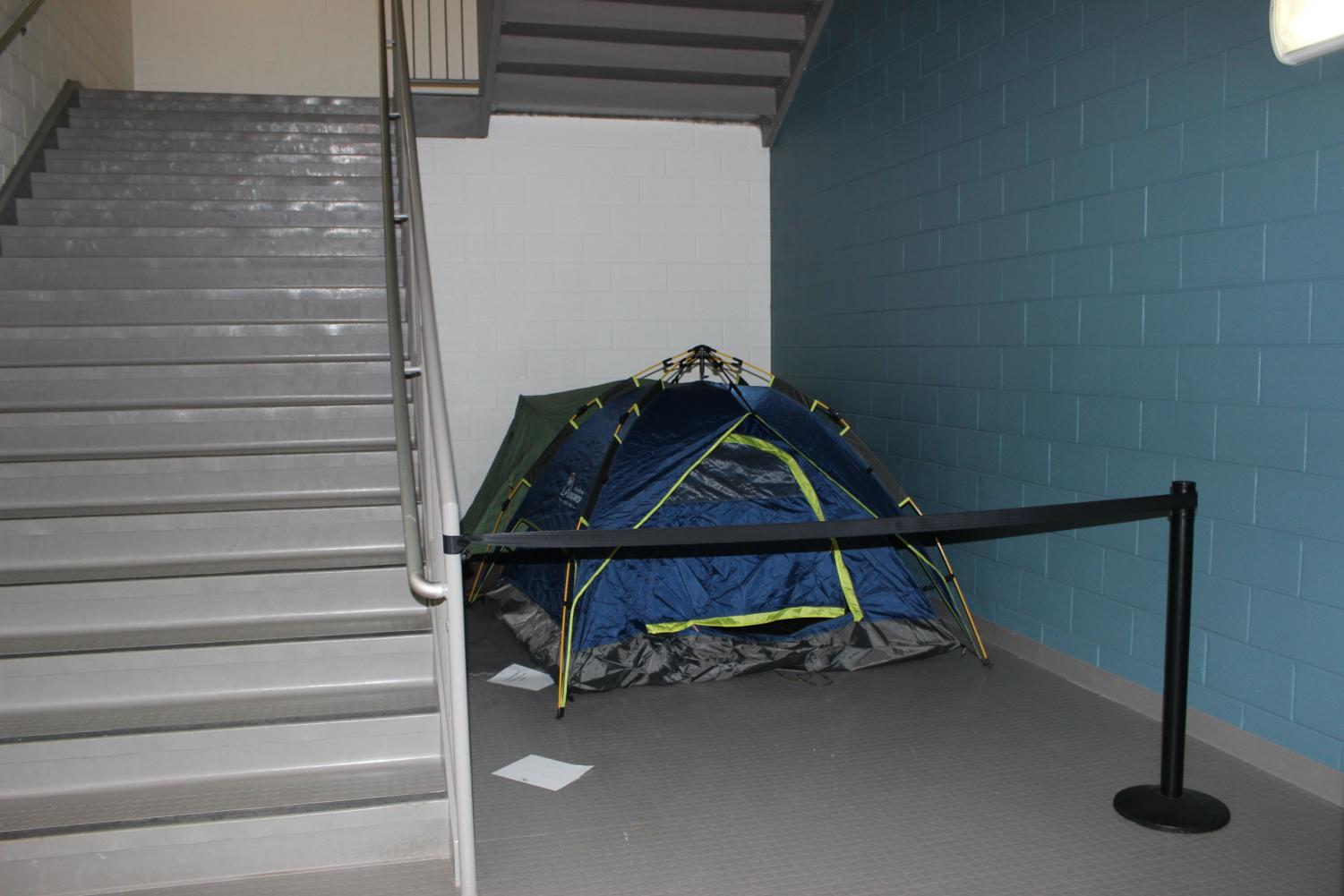"""The mysterious tent appeared around two months ago. Rumors have been circulating among students about what it could hold. """"Between third and fourth period my friends and I would sneak by the stairwell to see if anyone was there, """" junior Elena Harris said."""