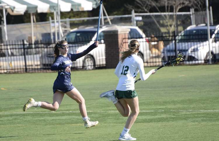 +Kaila+Stasulli+is+a+defender+on+girls+varsity+lacrosse+even+though+Stasulli+is+only+a+freshman.+%E2%80%9CBeing+on+varsity+is+definitely+a+challenge+but+it+is+also+very+fun%2C%E2%80%9D+freshman+Stasulli+said.%0A