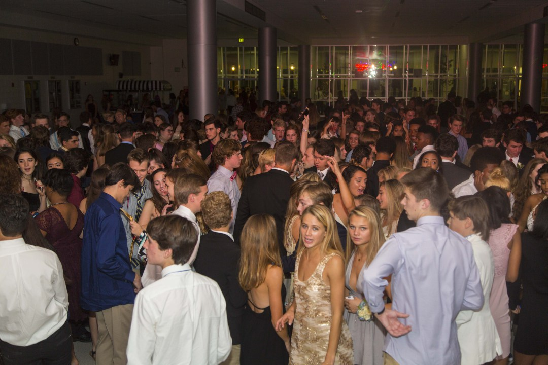 "The homecoming dance is a beloved high school tradition that includes dressing up and going out to party at the school with the rest of the student body. Last year, many students enjoyed themselves as they danced along to the DJ's music and hung out with friends. ""My favorite part of homecoming is getting to be all dressed up and fancy with my friends,"" senior Laura Folts said. (Photo courtesy of Tommy Gatz Entertainment.)"