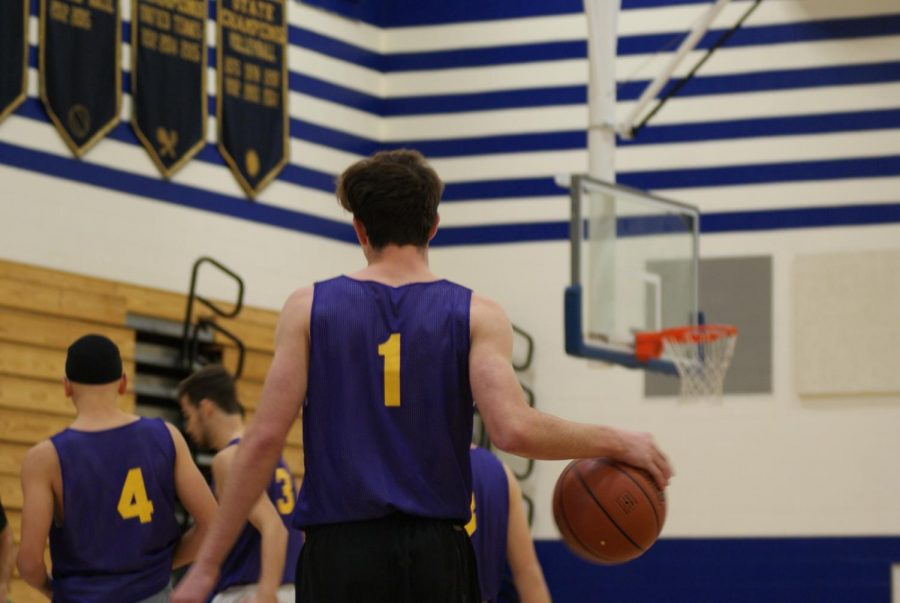 Junior Jeremy Simon dribbles towards the bench  after the Pacers call a time-out
