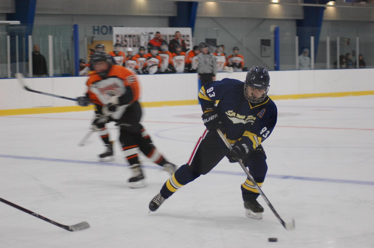 """The ice hockey team practices twice a week at the Naval Academy ice rink. Last year, they lost in the first round of playoffs against South River . """"It's kind of an unknown sport, it's not really advertised through the school,"""" junior Connor McGrath said."""