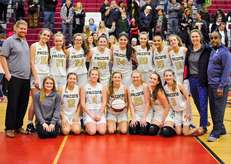Team photo of girls JV winning it all.