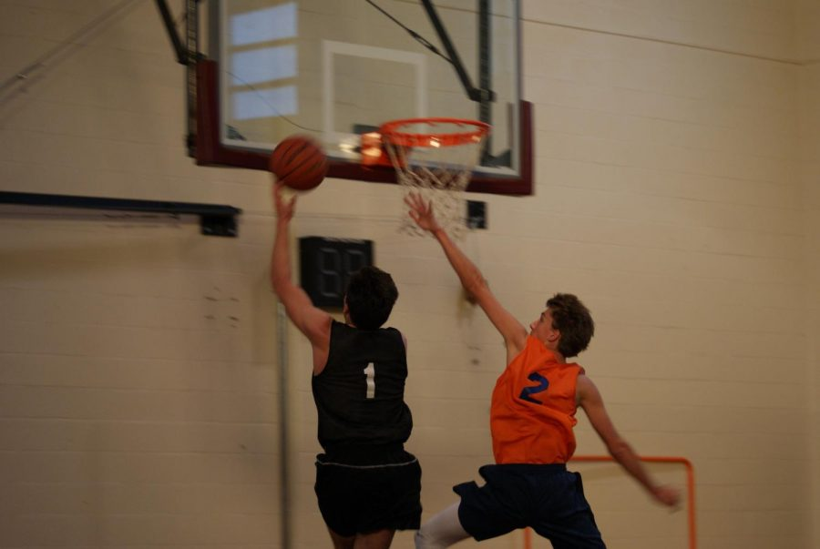 Senior Jake Hilliard successfully completes a chase-down block against Spalding senior, Alex Green.
