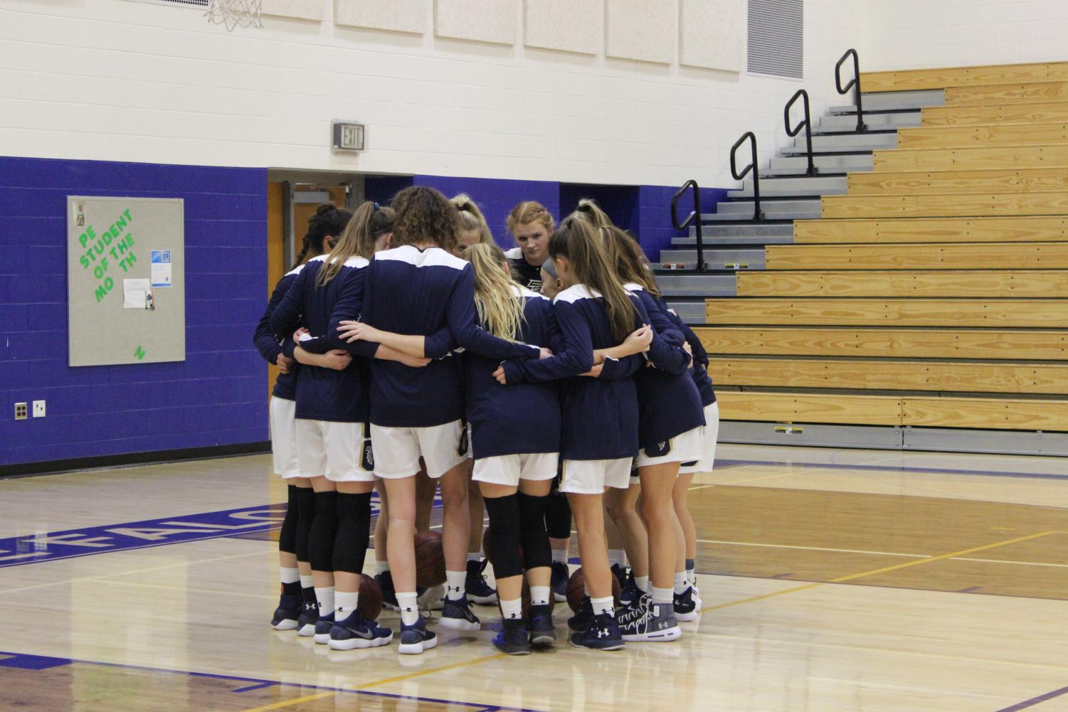 The teamhuddles up before taking the court