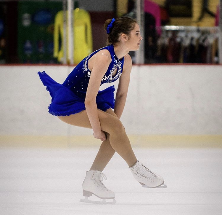 Senior+Anna+Trozzo+going+into+a+sit+spin+at+a+competition.+This+spin+requires+the+skater+to+come+into+a+squatting+position+on+one+leg%2C+with+the+other+extended.+%E2%80%9CI+really+enjoy+doing+sit+spins%2C%E2%80%9D+Trozzo+said.