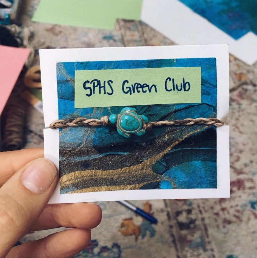 """This year, Green Club's focus is on marine conservation and plastic pollution awareness. Made by club members, these fashionable bracelets were sold at all lunches to benefit Project Aware, a nonprofit that aims to reduce marine plastic pollution. """"As much as you can, use reusable things, since it's the smaller things that you do consistently that count,"""" Juliana Wilson, the co-president of Green Club said."""