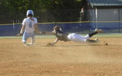 "Campbell Kline applying a tag on a runner sliding into second base. She is committed to University of Maryland College Park to play softball next fall. ""I wanted to stay close to home,"" Kline said."