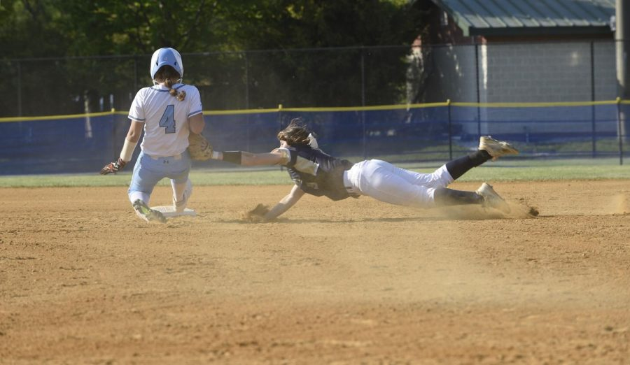 """Campbell Kline applying a tag on a runner sliding into second base. She is committed to University of Maryland College Park to play softball next fall. """"I wanted to stay close to home,"""" Kline said."""