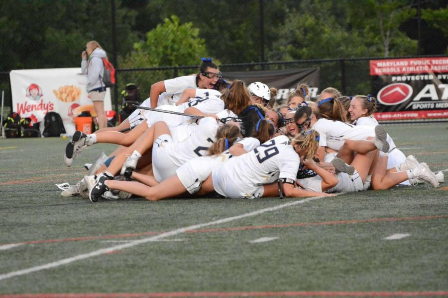 Girls+lacrosse+piles+on+top+of+each+other+after+winning+the+4A+state+title.+The+game+was+played+at+Paint+Branch+High+School+in+Burtonsville%2C+Maryland