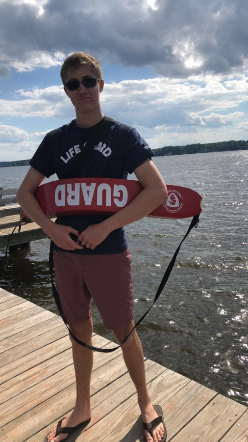 """Senior Bobby Davids patrols the Severn River as a lifeguard at Round Bay Main Beach. He maintained a confident and positive attitude all summer and made a bond with the recurring swimmers. """"I do it for the kids who just want to love the water as much as I do,"""" Davids said."""