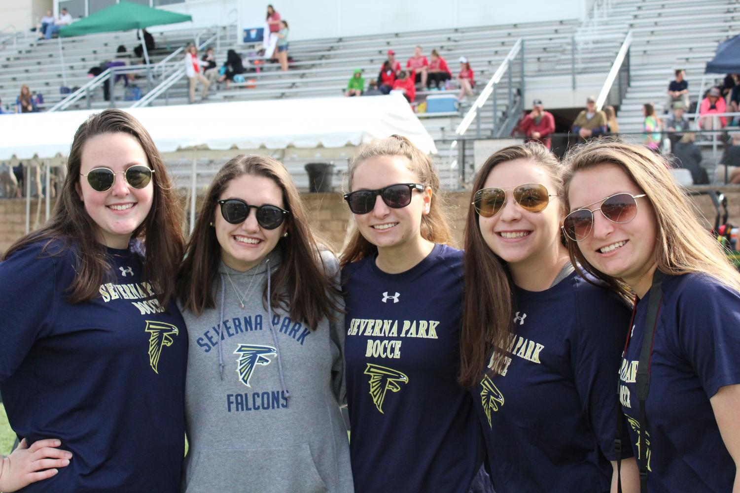 "Part of Severna Park's Team three gather for a picture before the last game. Seniors Elle Johnson (left), Julia Myers (second from left) and Elisabeth Eufemia (second from right) all gather for their last game of the season. ""I've been apart of Unified Sports for 12 seasons, and it has become a big part of my life throughout high school"" Eufemia said."