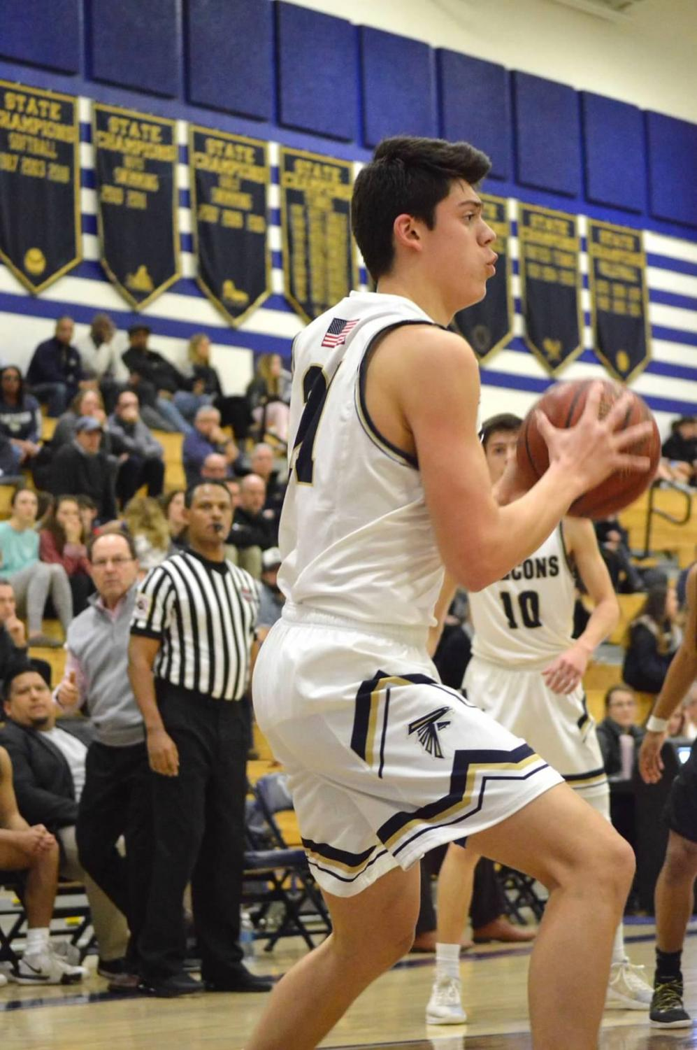 """Senior Orion Young receives a pass and goes up for the shot. As one of the premier bigs, Young is one of SPHS' many hard working weapons. """"We have a great group of guys who will push each other every day,"""" senior Eric Bloom said."""