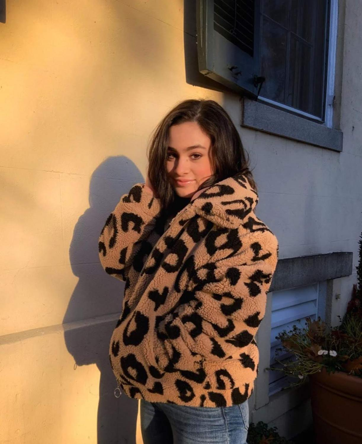 """Senior Sofia Urrutia styling a leopard-print teddy coat. Being a Pinterest-guru. Urrutia looks forward to making her outfits. """"I love how the jacket adds an element of chic style to any winter outfit while also keeping me super warm,"""" Urrutia said."""