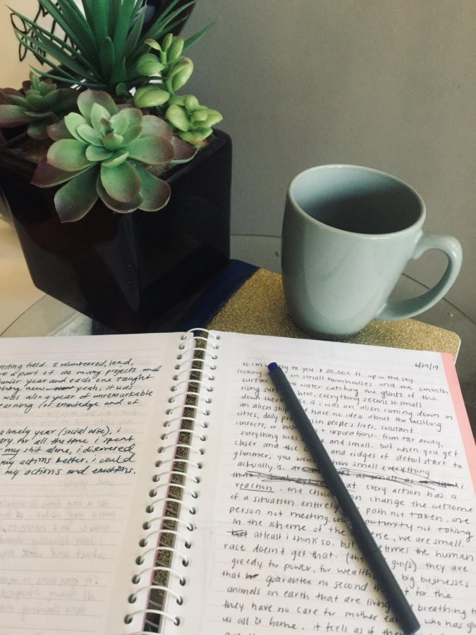 """Freshman Krista Gretz started journaling regularly two years ago. Gretz likes to journal whenever she feels stressed or overwhelmed. """"I can just write all my thoughts down and it clears my mind, making me feel better afterward,"""" Gretz said."""