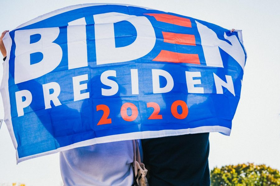 An american waving a Biden flag. Biden won the 2020 election by defeating the incumbent Donald Trump in November.