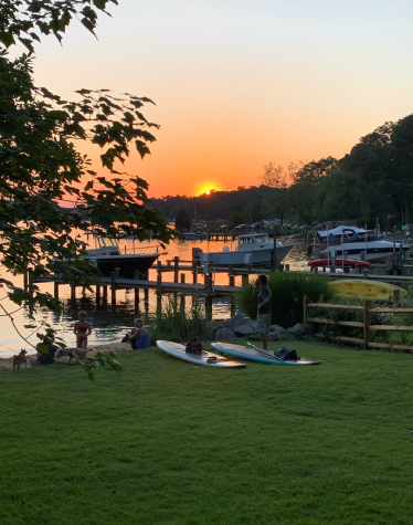 The view from Sunset Beach on Friday June 4. There were people who had their dogs there and there were a few people that went paddle boarding to watch some of the sunset. Every sunset is different there and that is part of the beauty of it.
